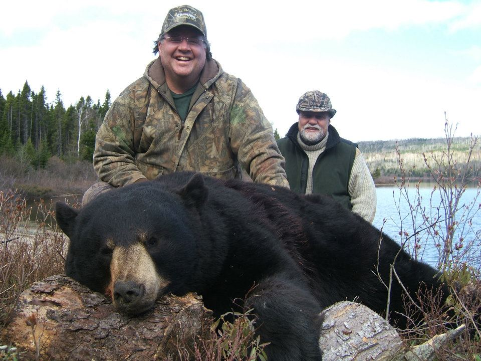 hunters posing with big game bear