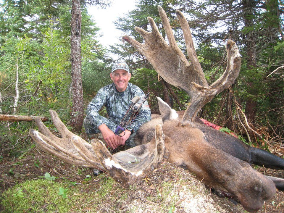 Hunter posing with big game moose